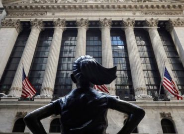 US markets close higher but not on their highs